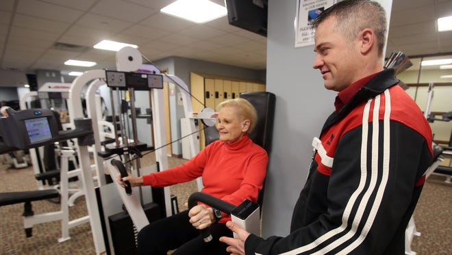 """Mary Timney of Peekskill works out with Matt Haun, an exercise physiologist, recently at Hudson Valley Hospital in Cortlandt Manor. Timney says it took a year and a half to get diagnosed. """"But I know my body, and this doesn't feel right,"""" she said."""