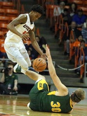 UTEP senior guard Omega Harris leaps in the air while