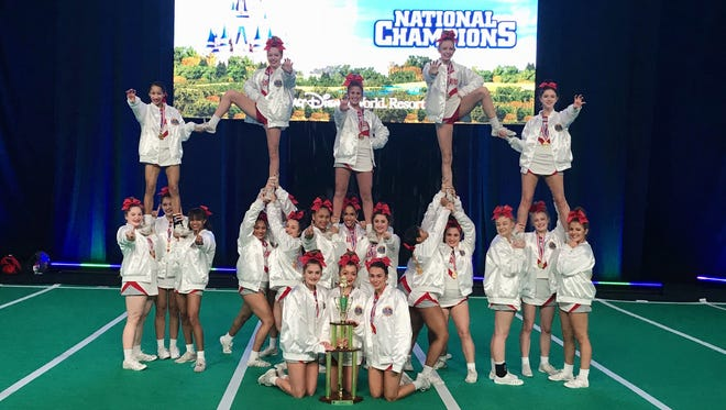The Fishers High School varsity cheer team poses after winning a national title on Sunday. The team placed first in its division, the first Indiana team to do so.