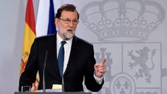 Spanish Prime Minister Mariano Rajoy speaks to reporters