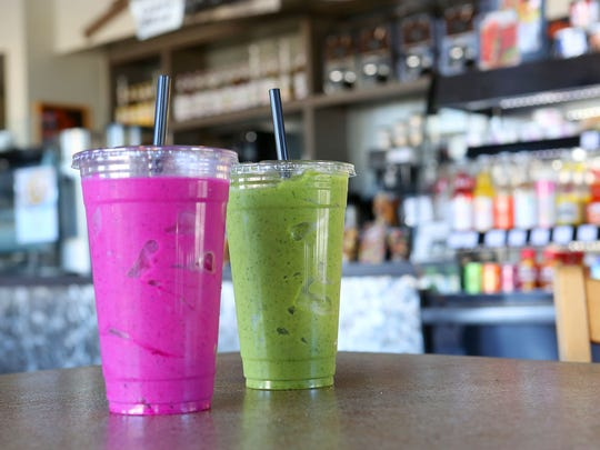 A pitaya smoothie, left, and a kale smoothie at Sip Coffee House and Juice Bar in Indio, Monday, November 2, 2015.