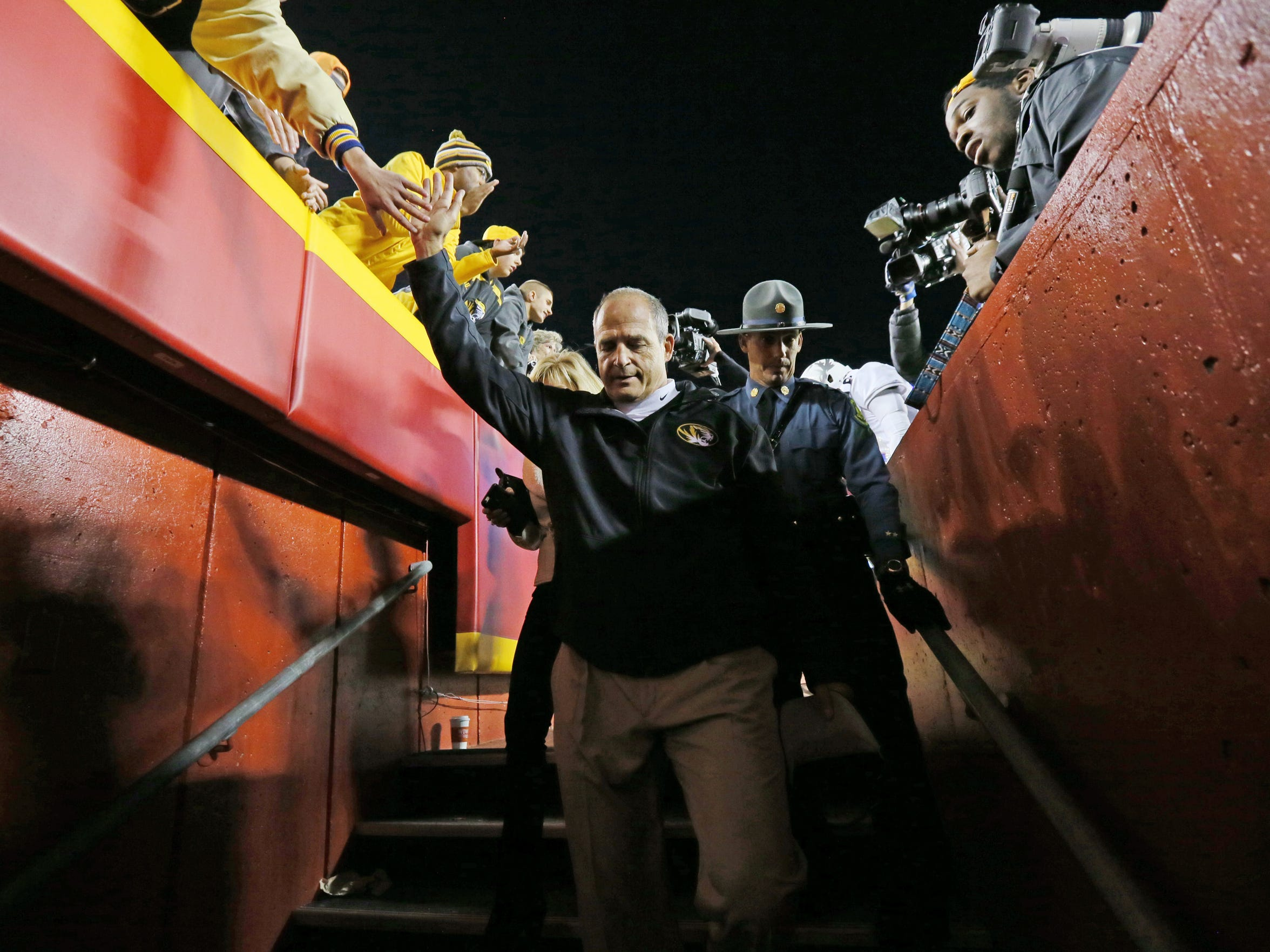 Missouri coach Gary Pinkel leaves the playing field after his team beat Missouri Saturday. Pinkel announced his retirement earlier in the week, effective at the end of the season.