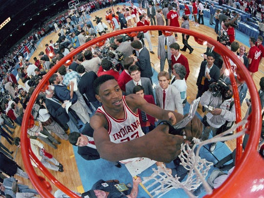 Indiana's Keith Smart, center, cuts the net at the Superdome after Indiana defeated Syracuse, 74-73, to win the NCAA Championship.