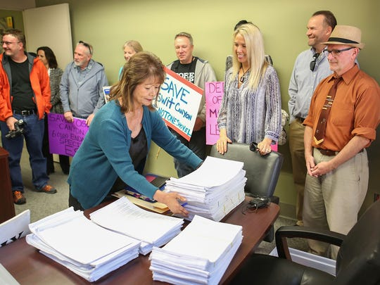 Palm Springs Interim City Clerk Kathleen Hart receives thousands of signatures from the Committee to Save Oswit Canyon at City Hall, January 26, 2017.