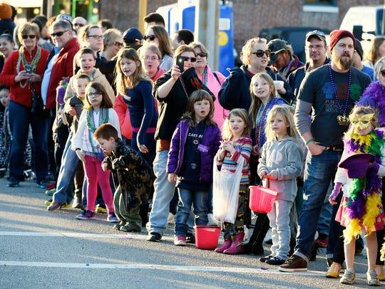 Parade watchers line West Franklin Street Saturday