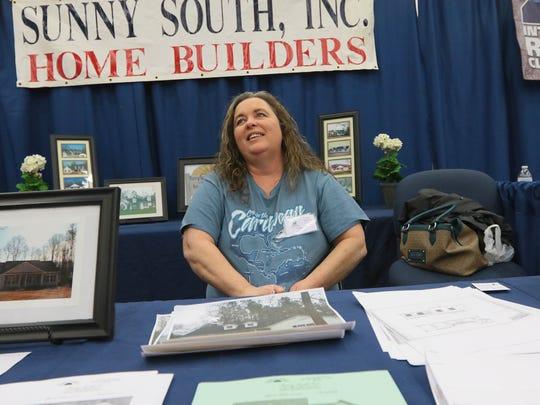Hope Williamson of Sunny South Inc. homebuilders talks about the increase in business during The Upstate's Home & Garden Expo on Saturday at the Civic Center of Anderson.