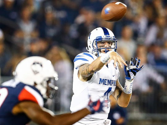University of Memphis quarterback Riley Ferguson makes a pass against the University of Connecticut defense during second quarter action in East Hartford, Conn., Friday, October 6, 2017.