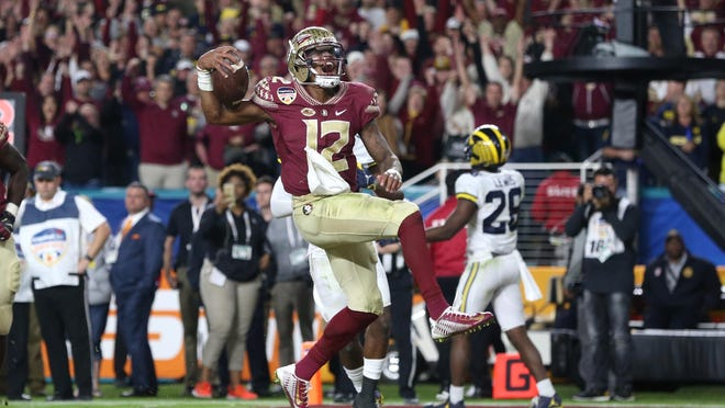 FSU's Deondre Francois rushes in a touchdown in the fourth quarter against Michigan during the Seminoles' win in the Orange Bowl on Dec. 30.