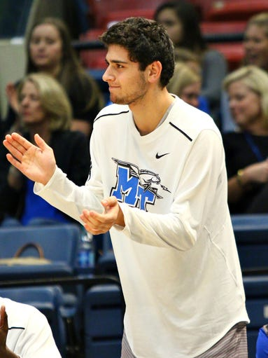 MTSU guard Chase Miller cheers on teammates during