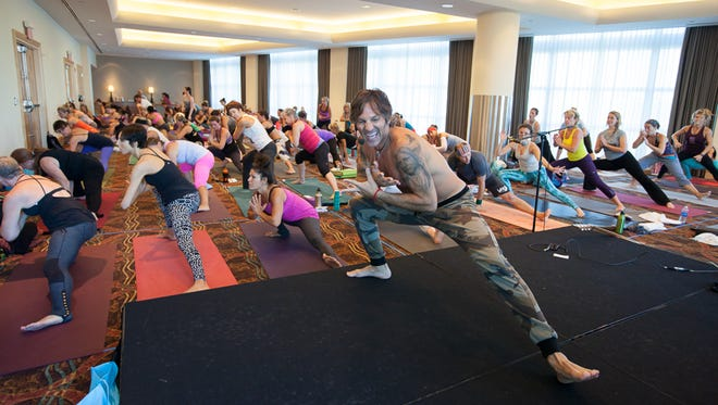 Eric Paskel leads a class at the Yoga Journal Conference Florida 2013.
