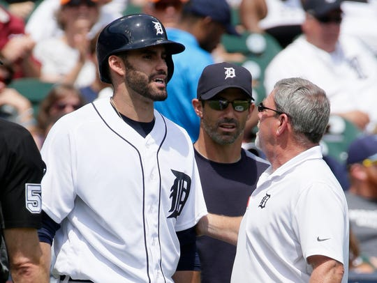 J.D. Martinez talks with Tigers trainer Kevin Rand,