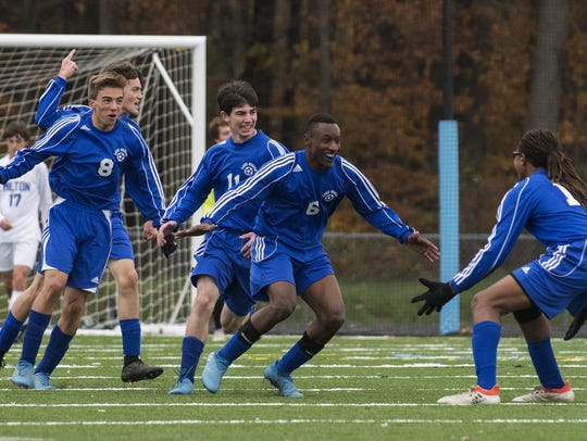 Lake Region celebrates a goal during the Division II