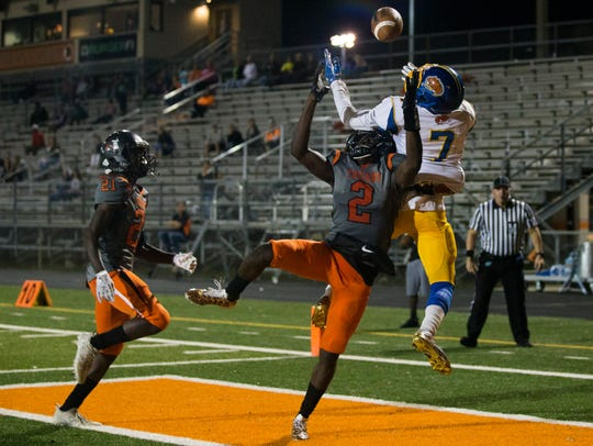 Lely's Nelson Charelus (2) breaks up a potential touchdown