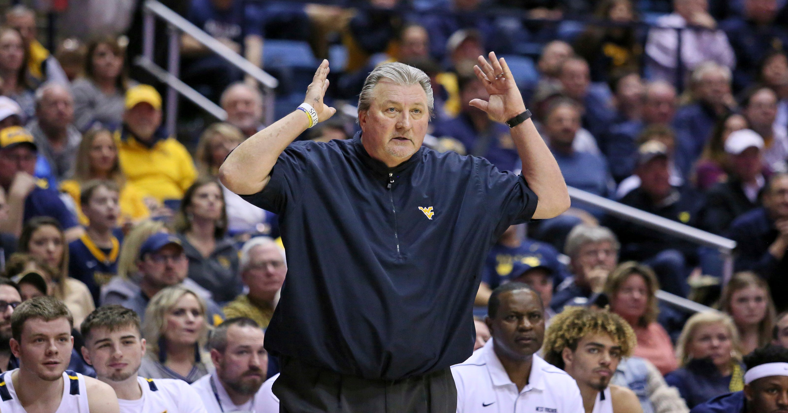 Bob Huggins ties Dean Smith for sixth all-time among Division I coaches with 879th win