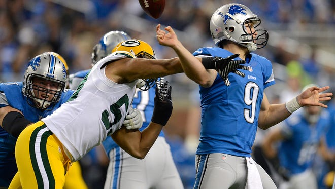 Green Bay Packers linebacker Nick Perry (53) hits Detroit Lions quarterback Matthew Stafford (9) to cause a fumble in a 2013 game.