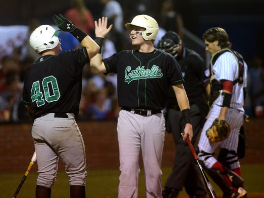 Catholic High School's Evans Bozeman, right, is congratulated by teammate Jimmy Richardson on a run in Tuesday night in a 1-4A semilfinal against West Florida High School.