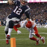 Patriots quarterback Tom Brady (12) tries to dive past Chiefs free safety Husain Abdullah.