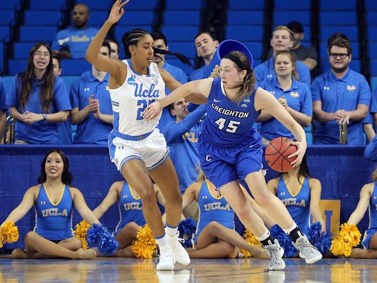 Crieghton forward Audrey Faber (45) drives as UCLA forward Monique Billings (25) defends in the first half of a second-round game in the NCAA women's college basketball tournament in Los Angeles, Monday, March 19, 2018. (AP Photo/Reed Saxon)