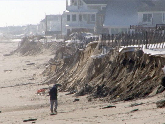 Eroded dunes are shown along the coastline in the northern end of Normandy Beach  Monday, January 25, 2016.