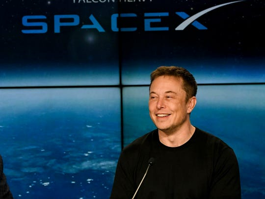Elon Musk, CEO of SpaceX, answers questions during a press conference following Tuesday's Falcon Heavy launch from Kennedy Space Center.