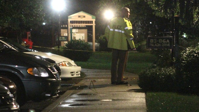 Police investigate the scene at Paladin Club Condominiums about 1:30 a.m. on Sept. 22, 2013, where newlyweds Joseph and Olga Connell were killed.