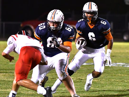 Dickson County's Darian Burns picks up a block from