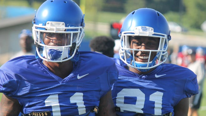 UK wide receivers Isaiah Epps, right, and Tavin Richardson, left, prepare for practice during preseason camp in 2017.