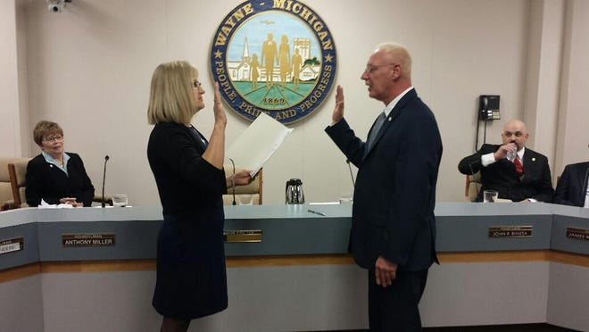 Wayne Councilman Anthony Miller is sworn in by his sister Deborah Ann Archer at the start of his first term.