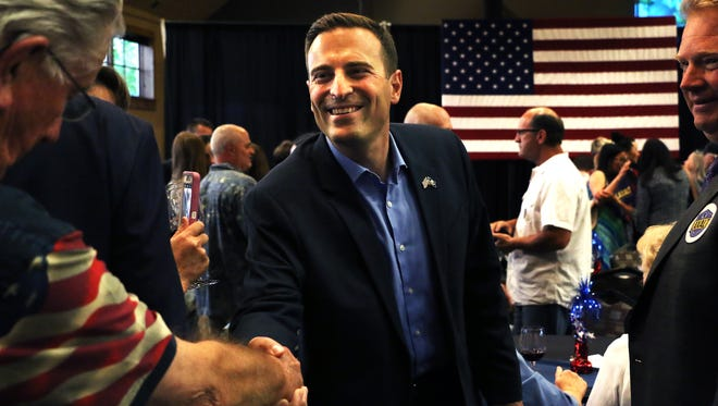 Adam Laxalt, Republican candidate for Nevada governor, greets supporters at a campaign party on the night of the Nevada primary, June 12, 2018 at The Grove in Reno.