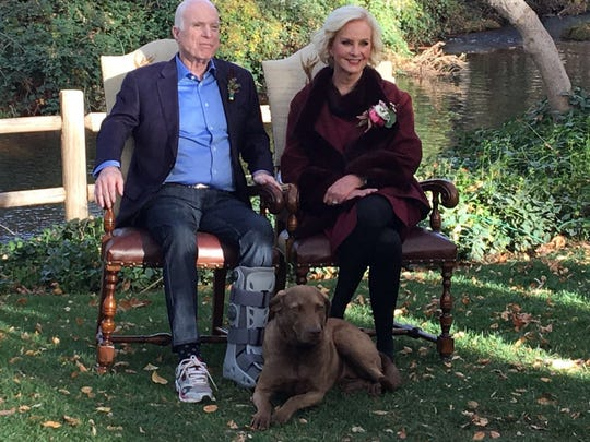 John and Cindy McCain pose with their dog, Burma, in a photo from daughter Meghan McCain's 2017 wedding at the family home in Cornville, Arizona.