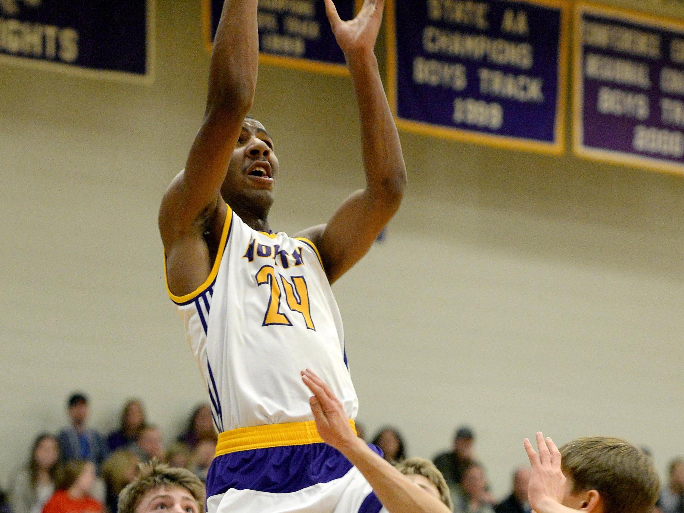 Austin Nelson is the leading scorer for the 13-0 North Henderson basketball team.