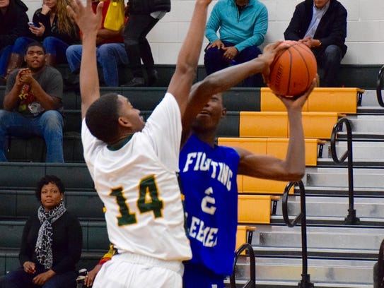 Robert E. Lee's Darius George goes up for a shot as