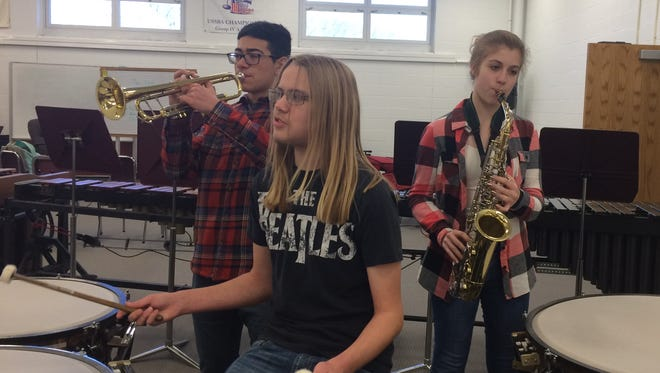 Verona High School band students, from left, Mark Walsh, Mike Petillo and Anna Konrad-Parisi perform on their instruments.