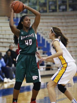 Carmel's Amy Dilk defends Lawrence North's Lamina Cooper as she sets to pass off to a teammate in the Wildcats' 56-50 win at Carmel on Tuesday, Dec. 2, 2014.