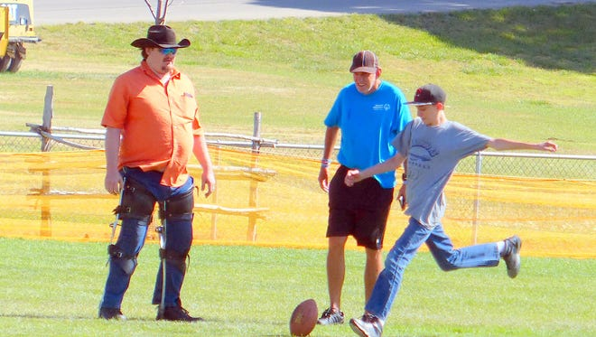 A participant in the punting, passing and kicking contest Sunday staged by the Ruidoso Parks and Recreation Department takes aim at a football.
