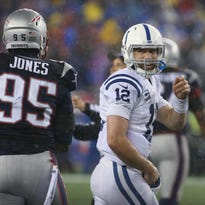 Indianapolis Colts quarterback Andrew Luck has a smile for New England Patriots outside linebacker Jamie Collins and teammate Chandler Jones after a big hit on Luck in the second half. The Colts visited Gillette Stadium for the AFC Championship game with the New England Patriots Sunday, January 18, 2015.