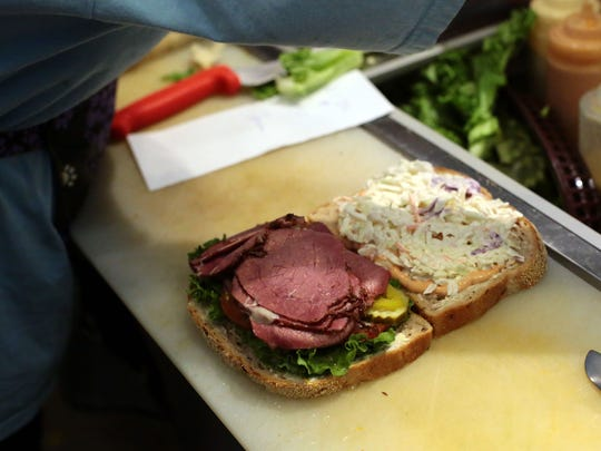 """A """"My Friend Molly"""" sandwich is put together at The Sandwich Spot in downtown Palm Springs on Friday."""