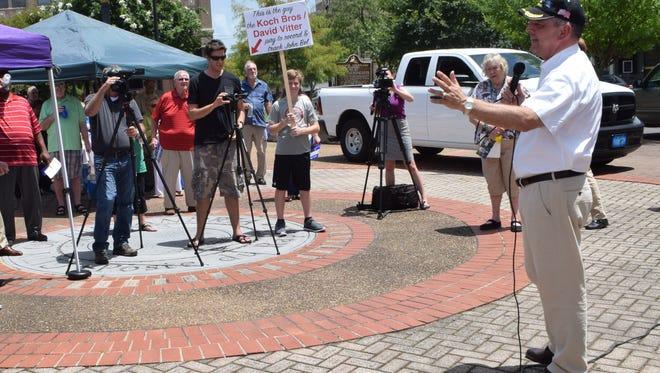 John Bel Edwards (right foreground) speaks during his gubernatorial campaign stop in Alexandira on Thursday in Alexander Fulton Park.