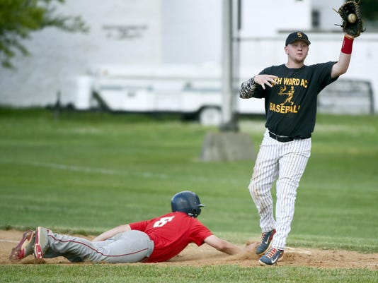 Myerstown Kyle Knight  slides safely back into first baseman ad 5th Ward's Brycen Loeper takes the throw.