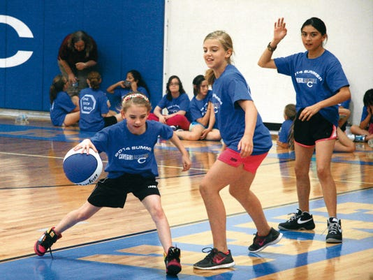 Matt Hollinshead — Current-Argus Marley Suggs (10, left) drives to the basket at Carlsbad High's Cavegirl Basketball Camp on Tuesday, May 27, 2014. The three-day camp will be held at the CHS Gymnasium again on May 26-28.