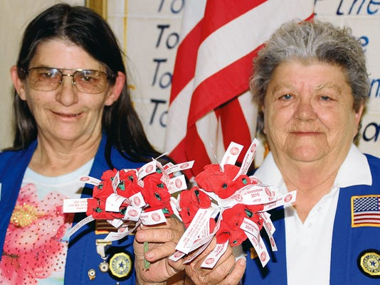 Bill Armendariz - Headlight Photo   From left are Robin McCutcheon, American Legion Auxiliary Poppy Chair, and American Legion Auxiliary Unit 4 President Barbara Horning hold bouquets of poppies that just came in for Saturday's Poppy Day distribution. Auxiliary members will be at local storefronts with poppies.