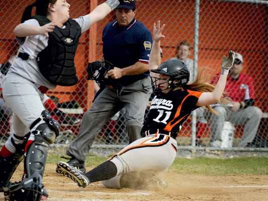 Palmyra's Megan Quigley slides safely into home plate before Susquehanna Township's Katelyn Sowers could get the throw and apply the tag during the Cougars' 8-2 win on Wednesday. Palmyra scored all eight of its runs in the second inning en route to the win.