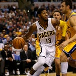 Indiana Pacers forward Paul George (13) drives the baseline against the Golden State Warriors at Bankers Life Fieldhouse on Dec. 8, 2015.