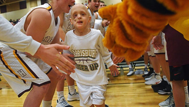 Emmett Zorr, 5, the honorary team captain of the Harrisburg boys basketball team, is introduced before a game against Watertown Tuesday, Feb. 21, 2017, at Harrisburg High School in Harrisburg, S.D. Late last year, Emmett had a tumor removed from his face, and is currently going through chemotherapy. This wasn't the first time Zorr has been through this. When Emmett was 3-years-old he was diagnosed with rhabdomyosarcoma after a tumor was found on his face. The Harrisburg boys won Tuesday's game against Watertown 42-35.