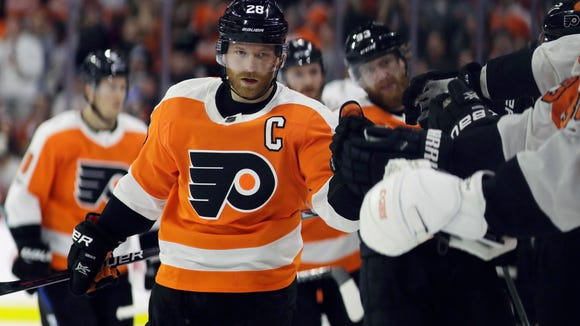 Philadelphia Flyers' Claude Giroux celebrates with his teammates after scoring a goal against the Chicago Blackhawks during the first period of an NHL hockey game, Thursday, Nov. 9, 2017, in Philadelphia. (AP Photo/Matt Slocum)