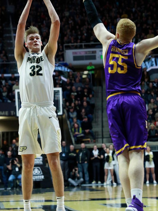 Purdue center Mat Haarms (32) shoots while defended by Lipscomb center George Brammeier in the first half of an NCAA college basketball game, Saturday, Dec. 30, 2017, in West Lafayette, Ind. (AP Photo/R Brent Smith)