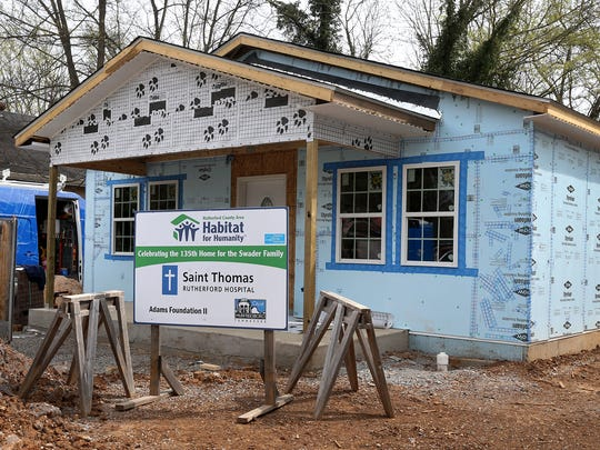 Several Oakland Middle School teachers are helping build Camisha Swader, Habitat for Humanity home on Richardson Ave. in Murfreesboro.