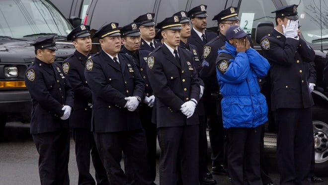 New York City police line up on Jan. 4 after the funeral service for officer Wenjian Liu.