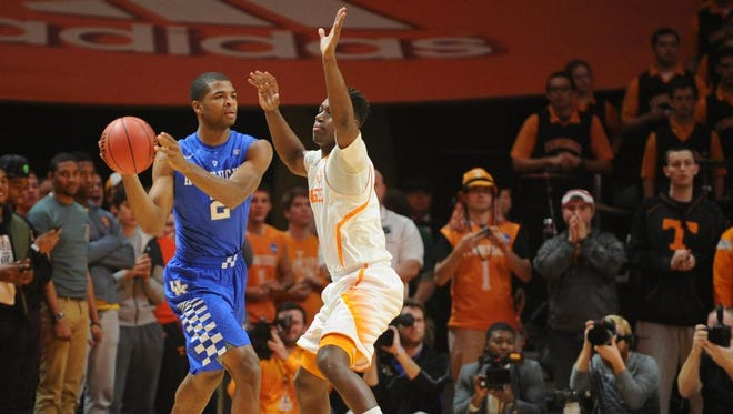 Feb 17, 2015; Knoxville, TN, USA; Kentucky Wildcats guard Aaron Harrison (2) passes the ball against Tennessee Volunteers forward Armani Moore (4) during the game at Thompson-Boling Arena. Mandatory Credit: Randy Sartin-USA TODAY Sports