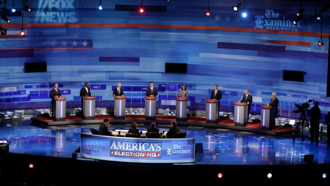 Republican presidential candidates debate in Ames, Iowa, on Aug. 11, 2011.
